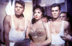 One of her many movies: Gina Lollobrigida as Lola in the 1956 film Trapeze (1956), alongside Burt Lancaster as Mike Ribble (left) and Tony Curtis as Tino Orsini (right)