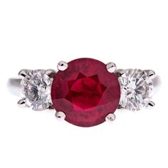 Ruby Diamond Platinum Three-Stone Ring   From a unique collection of vintage engagement rings at http://www.1stdibs.com/jewelry/rings/engagement-rings/