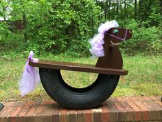 Rocking horse made with a tire! Husband and I made this for the grand kid...
