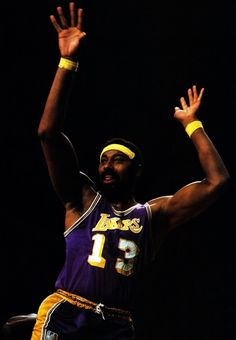 Wilt Chamberlain....Still holds the record for most points scored in a NBA Game....100 Points! YEAH!!!!