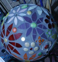 Recycled bowling ball + mosaic gazing ball.