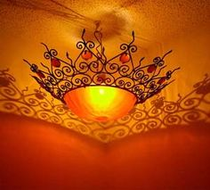 Moroccan hanging lampsAn unusual wrought iron resin chandelier /sun lamp, all handmade with alot of details, made of heavy gauge iron frame, it has a resin bowl  in the center . This exotic sun lamp measures 25