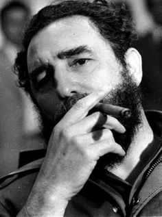 January 1976: Fidel Castro smokes a cigar during a news conference at the Jose Marti airport in Havana.