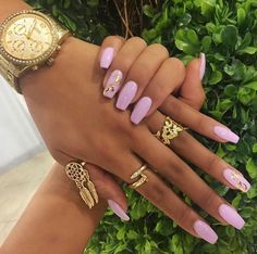 Pink nails with gold rings