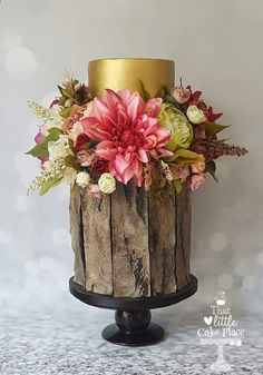Wedding cake with aged wood, gold and flowers - That Little Cake Place