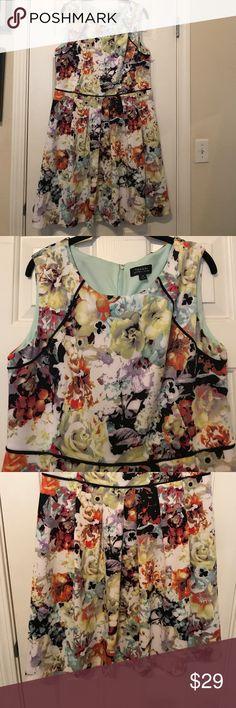 Worn once Tahari dress. Sleeveless. Summery sleeveless Tahari dress. Fully lined. Flower print. Pleats. Worn once to a party. Haven't worn it since. Hits the knee. Tahari Dresses