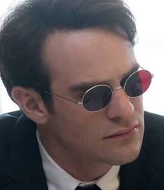 98b059e74d Charlie Cox as Matt Murdock   Daredevil wears a pair of custom round  sunglasses with red lenses in the Netflix series Daredevil.