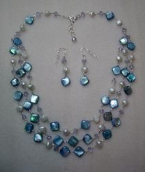 Triple strand sterling wire wrapped necklace with shell pillow beads, fresh water pearls and Swarovski crystals. SOLD