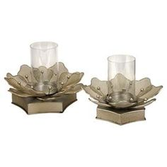 "Set of two iron floral candleholders with glass votive holders.   Product: Small and large candleholderConstruction Material: Iron and glassColor: ChampagneAccommodates: (1) Pillar candle each - not includedDimensions: 7.25"" H x 10"" Diameter (large)"