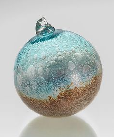 """Seashore"" #art glass #ornament by Daniel Scogna. The beauty of a pristine shoreline is captured in blown glass: cool blue water flows into a speckled expanse of sand, separated only by a gentle spray of seafoam. An Artful Home exclusive."