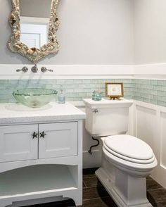 Coastal bathroom with shell mirror.... Featured on Completely Coastal: http://www.completely-coastal.com/2017/07/coastal-cottage-decor-blue-and-coral.html