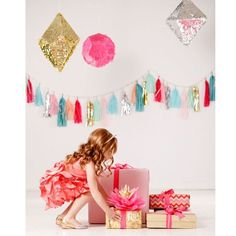 Love this picture! You don't need much to create a beautiful setting!! Adding tassels + gems + presents = perfect backdrop. Pic via pinterest #glam #backdrop #gems #kidsparty #kidsfashion #sparkly #posh #pohkids #storybookbliss #partyideas #partydecor #inspiration #igkidsfashion #allthingspretty