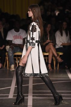 """Givenchy's Riccardo Tisci loves a lady's subversive side, and these thigh-high lace-up boots with his new """"half stacked/half spike"""" heel detail certainly get right to the point. [Photo by Giovanni Giannoni]"""