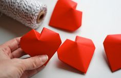 3D origami hearts--string them into a garland for Valentine's Day