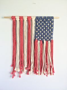 Beautiful, patriotic handmade wall hanging. Hand dyed red white and blue cotton rope macrame braided to the perfect rustic and indie vibe flag hanging.  It measures 21 across and 26 long. It comes with fishing wire to hang the macrame or that can be removed and it can be hung with two nails on eith