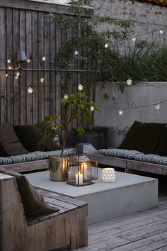 A blend of rustic furniture and classy modern decor in the courtyard. Plenty of atmospheric lighting for evenings outdoors.
