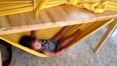 Make a kid size hammock out of a sheet tied over a table. They will love it!