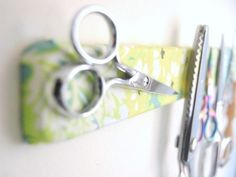 A fabric covered magnetic knife strip.  Buy magnetic strip from Ikea.  Great for all those metal bits in the sewing room.