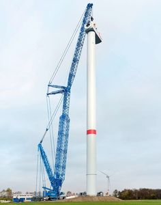The first Liebherr LR 11000 to be fitted with a Power Boom attachment has gone to work in Germany. The 1,000 tonne crane used the new P.Boom for the first time to place a large turbine house, weighing almost 220 tonnes onto a tower near Cuxhaven in North Germany.