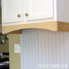 I like this added trim to the bottom to update your cabinet look