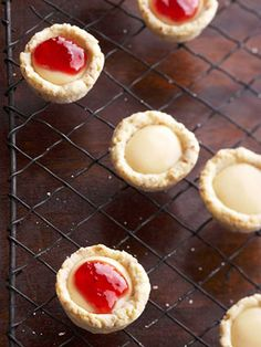 Strawberry Cheesecake Tartlets A filling of yummy strawberry preserves crown the top of each of these bite-size cheesecake cookies.