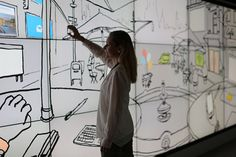 <p> Microsoft brought an interactive digital wall to C.E.S. that allowed attendees to activate illustrations by touch, revealing key stats...