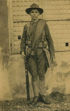 A US dough-boy WW1. Note the blanket carried across the chest. The expedition hat was still standard issue.