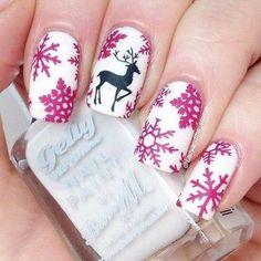 Snowflakes and Reindeer Christmas Nail Art.