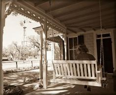 country porch with swing by louellaa