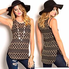 Black gold embellished tank top tunic Available in Small, Medium, and Large. Black tank top covered in metallic gold shiny circular pattern. Slight side slits. Back almost looks like a very thick racer back. Scoop neck line. Completely sleeveless top, with patterns of metallic shiny gold foil thread in alternating tribal geometric patterns of lines, circles, and Diamonds. Circles are shaped almost like the circles on a peacock feather pattern. Longer than the picture, could be worn like a…