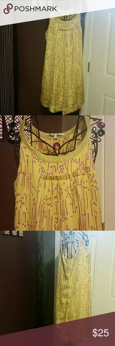 """Lemon Yellow Halter Style Shift Dress sz Medium Lemon Yellow Shift Dress with gorgeous fushia contrasting accents. Made by Collective Concepts for Anthropologie  High neckline is a shimmering gold/yellow color, dress is fully lined in great condition from a smoke and pet free  100% polyester, lining is a rayon/ polyester blend  Approx Measurements :  Bust 16.5"""" Length 34"""" Anthropologie Dresses"""