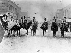Men on horseback in an intersection of Las Animas, Bent County, Colorado