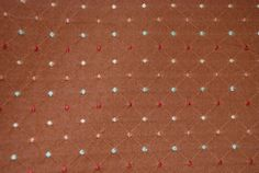 This copper dot and diamond fabric goes with many fabrics, with its multi color dots  Repeat V 1 3/4 H 1    -The listing price is per yard.  -The