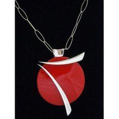 Colgante de plata con corian rojo