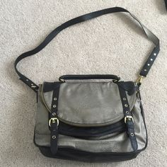 Steven Madden Crossbody Steven Madden crossbody in pewter and black with gold hardware. This bag has  a zipper compartment once flipped open. The strap for the crossbody can also be adjusted to various lengths. Steve Madden Bags Crossbody Bags
