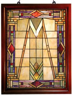 <li>Elegant Mission glass window panel has been handcrafted using methods first developed by Louis Comfort Tiffany<li>Window panel contains 247 hand-cut pieces of stained glass<li>Lighting includes hanging hardware for easy use