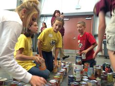 Stetson Elementary School students collaborate with students from other area schools during the 'Canstruction' event at Care and Share Food Bank of Southern Colorado October 29. Recognized as a high performing school during the previous year, schools came together as part of the Harvest of Love food drive that continues through Thanksgiving.