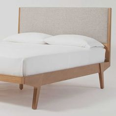 Inspired by Scandinavian modernism, our Modern Bed marries a simple upholstered headboard with playfully angled legs in a warm pecan finish. Modern Bed Linen, Modern Headboard, Master Bedroom Minimalist, Wood And Upholstered Bed, Best Bed Designs, Mid Century Bed, Neutral Bedroom Decor, Peaceful Bedroom, Oversized Furniture