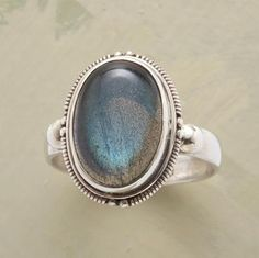TWILIGHT RING -- The ambient light between night and day is caught in a labradorite cabochon surrounded by a delicately patterned sterling silver bezel. Whole and half sizes 5 to 9.