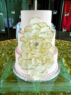 light pink smooth buttercream with fondant flower and hand painted gold trim. #weddingcake #elegantweddingcake