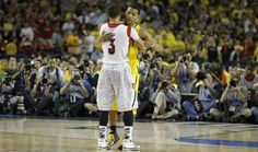 Louisvilles Peyton Siva hugs Michigans Trey Burke in the last second of the game during the 2013 NCAA championship game between Michigan and Louisville at the Georgia Dome in Atlanta on Monday, April 8, 2013.