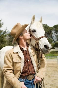 Man kissing his horse. How to Get to Know Your New Horse Better - also see link here on Five Tips for Getting That New Horse to Love You --> http://www.wayofthehorse.org/Essays/5-tips-to-love.html