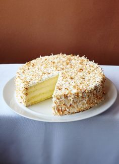 Cake of the Day: Thomas Keller's 7-Layer Coconut Cake - four layers of coconut sponge cake, three layers of thick Bavarian cream, and covered with spreadable meringue and toasted coconut flakes.. Use this recipe for cake and meringue - http://www.saveur.com/article/recipes/thomas-kellers-coconut-cake, and any good Bavarian cream recipe for filling.