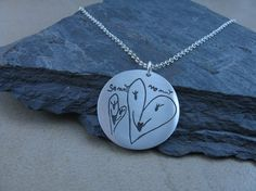your child's artwork on a necklace... cute mothers day gift idea :)