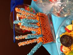 Bubble Guppies birthday party.  candy covered pretzel sticks