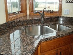 Baltic brown granite countertops light maple floors add for Template for granite countertops