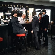 Paul McCartney, Richard Starkey, George Harrison, and John Lennon (Four Beatles walk into a bar... (1965) the movie Help!)