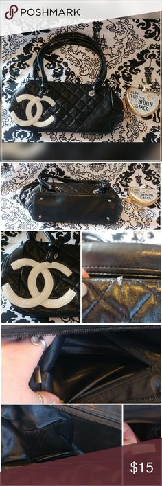 Black purse with white double c emblem Black purse with white double c emblem   - this purse features a cushioned design and black faux leather with CC emblem clean interior  - this purse is used person does show some signs of wear such as a few scuffs and one damage shown in pictures  - purses for cheap, no brand, night out, boho, Fashionista Bags Shoulder Bags