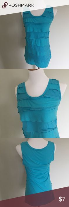 Sleeveless ruffle tank top Cascading layers of ruffles add interest and dimension to this top. Worn 2-3 times. In perfect condition. No signs of wear. Size Medium. Color is slightly off in the photos, it looks a wee bit darker in the pictures. I'd say it's more of an aqua. It's a really pretty color. Fabric is cotton and modal blend. Tops Tank Tops