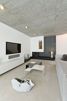 Czech design studio OOOOX designed this incredible modern house interior. The house was designed in an austere, minimalist style. Concrete Ceiling, Concrete Floors, Modern Interior Design, Interior Architecture, Contemporary Interior, Concrete Interiors, Muebles Living, Kb Homes, Lounge Design